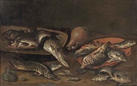 various fish on platters, an earthenware jug, and a small frog in the left foreground by isaac van duynen