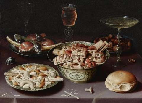 a still life of porcelain vessels containing sweets pewter plates bearing sweets and chestnuts three pieces of glassware and a bread roll on a table draped with a mauve cloth by osias beert the elder