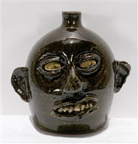 early rock tooth face jug with glazed eyes by lanier meaders