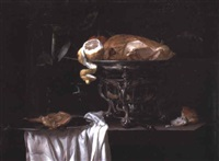 a roast guinea-fowl, an orange, and a peeled lemon in a chafing dish by heyman dullaert