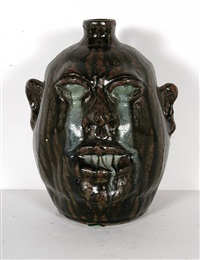 runny eyes and teeth face jug by lanier meaders