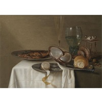 a still life with a half-peeled lemon on a pewter dish, a dried fish with capers, a wine glass, roemer, triangular salt cellar and a nautilus-shell cup on a table by maerten boelema de stomme