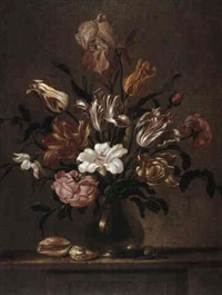 a still-life of tulips and other flowers in a glass vase  with seashells and a snail, all on a table by evert van aelst
