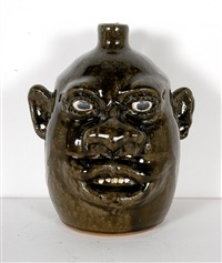negro stylized face jug by lanier meaders
