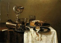 an overturned silver tumbler and a roemer on a pewter plate, a façon-de-venise wineglass, a nautilus cup, a pie and a lemon on pewter plates on a table by gerrit willemsz heda