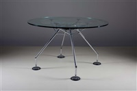 nomos table, circular version by norman foster