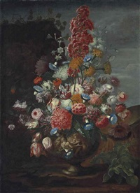 carnations, convolvulus, tuberoses, parrot tulips, roses and other flowers in a sculpted urn, in a landscape by karel van vogelaer