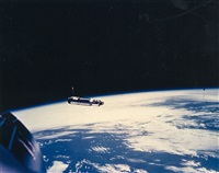 the agena target docking vehicle over the earth by david scott