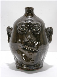 dark glazed face jug by lanier meaders