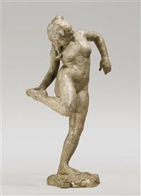 danseuse regardant la plante de son pied droit by edgar degas