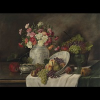 still life of carnations and fruit on a draped table by alois zabehlicky