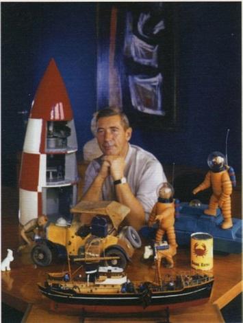 portrait du dessinateur père de tintin georges rémi dit hergé en compagnie de maquettes et figurines de ses héros by robert kayaert