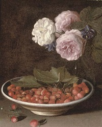 roses and campanula in a glass vase with wild strawberries in a bowl on a stone ledge by jean-michel picart