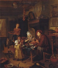 an interior with a family eating arounf a table, an artist's studio beyond by hendrik (h.) de valk