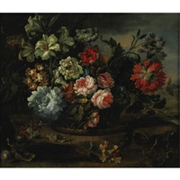 still life with flowers in a basket resting on a ledge by antoine monnoyer