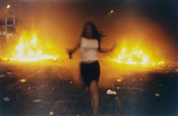 riot girl (kierra running past burning cars, shortly to be grabbed by the police, london) by vinca petersen