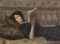 girl reading on a sofa by isaac israels