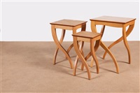 a pair of nesting tables, each comprising three tables (set of 6) by sir terence conran