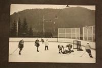 action d'un match de hockey sur glace avec l'équipe du japon, sur une patinoire en plein air by henri cartier-bresson