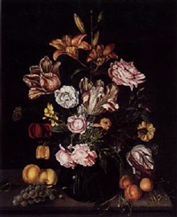 flower still life with tulip, roses and other flowers in a glass vase with peaches, grapes and a cricket, on a wooden table by johannes bosschaert