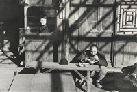 last days of the kuomintang, merchant waiting with man eating, beijing by henri cartier-bresson