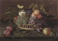 a wicker basket with white and blue grapes, peaches, an apple and vine leaves on a stone ledge by johannes bosschaert