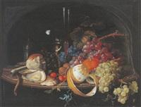 nature morte aux verres de vin, raisins, pipe, coquillages, citron dans une niche by abraham mignon