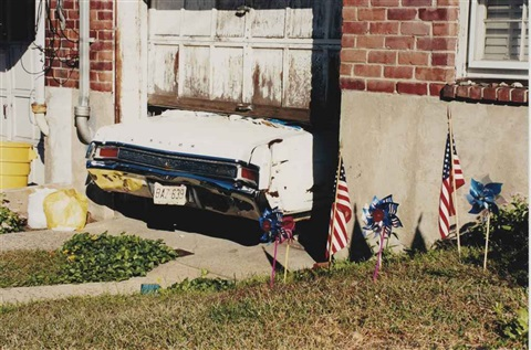 white car stuck in a garage, new york by martin parr