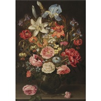 a still life of lilies, roses, iris, pansies, columbine, love-in-a-mist, larkspur and other flowers in a glass vase on a table top, flanked by a rose and a carnation by clara peeters
