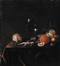 fruit in a porcelain bowl, radishes on a pewter dish, with a roemer and a breadroll on a draped table by paul van den bosch