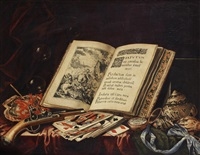 a still life of an open book, bubbles, coral, a flintlock pistol, playing cards, a pocket watch on a blue silk ribbon and a variety of shells on a table draped with a red and a green cloth by simon renard de saint-andre