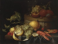a still life with crayfish, grapes, lemons, cherries, walnuts, a box with a berkemeier and peaches, all on a draped table by guilliam van deynum