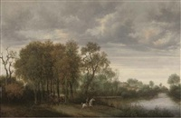 a wooded river landscape with a horseman and a horse and cart on a path by joris van der haagen