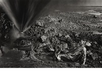 man lying in oil, kuwait by sebastião salgado