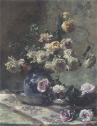 roses cascading from a china vase into a bowl on a draped table by flore gelendts
