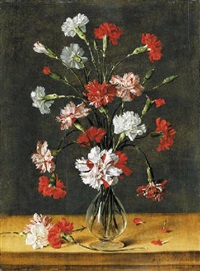 carnations in a glass vase on a stone table by philippe de marlier