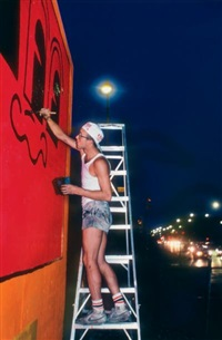 keith haring painting the house, bavery wall in 1982 by martha cooper