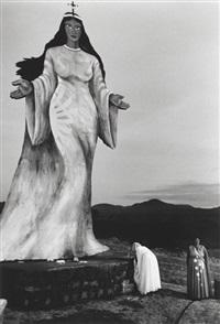 two women making an offering to a goddess statue, brazil by sebastião salgado