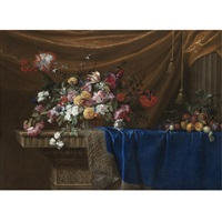 a still life of a basket of flowers and a mound of fruit on a sculpted stone table, partly covered with a blue velvet, gold-and-silver-fringed cloth with drapery and a stone column in the background by jean-michel picart