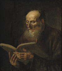 a bearded man reading by dirck van hoogstraten