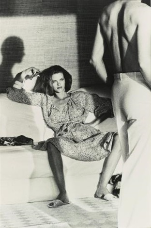 woman examining man us vogue st tropez from private property suite iii by helmut newton