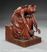 wood figure of a seated woman warming herself by auguste cornu