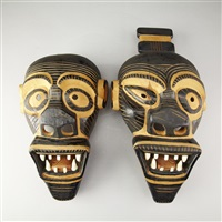 masks, male and a female (2 works) by jacob amatangeq