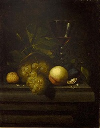 a still life with walnuts, a peach, prunes, grapes and a glass, all on a wooden table by johannes borman
