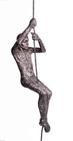 man climbing a rope by john r davies