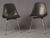 lot se composant de quatre chaises (set of 4) by george nelson and charles eames