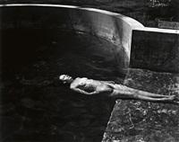 nude floating in pool by edward weston