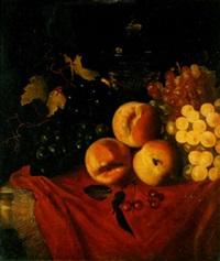 des pêches, des cerises, du raisin et un verre sur un entablement drapé by willem frederik van royen