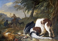 a spaniel with a dead heron and other birds in a wooded landscape, huntsmen and their dogs beyond by adriaen de gryef