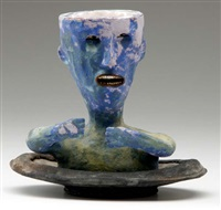 figural cup and saucer by wesley anderegg